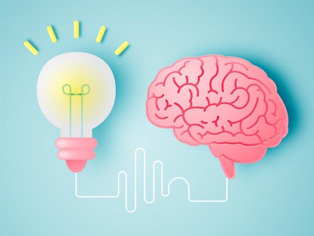 Gehirn mit ideenkonzept im papierkunststil