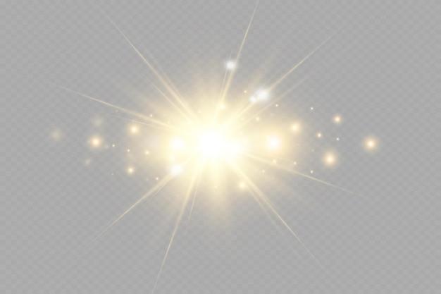 Gelb leuchtendes licht explodiert auf einem transparenten hintergrund funkelnde magische staubpartikel heller st...