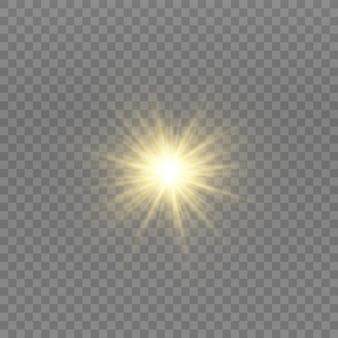 Gelb leuchtendes licht explodiert. funkelnde magische staubpartikel. heller stern. transparent strahlende sonne, heller blitz.
