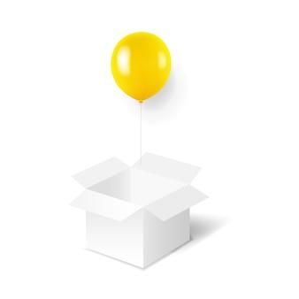 Gelbe luftballons mit weißer box