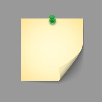 Gelbe note mit grüner drucknadel