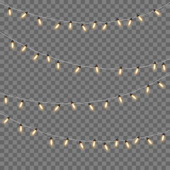 Gelbe weihnachtslichter isolierten realistische gestaltungselemente. weihnachtslichter lokalisiert auf transparentem hintergrund. weihnachtsglühende girlande.
