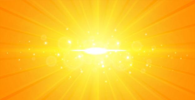 Gelber hintergrund des leuchtenden mittleren lichtstrahls