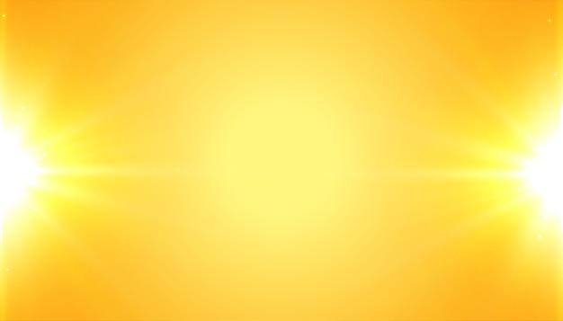 Gelber hintergrund mit glänzendem leuchtendem lichteffekt