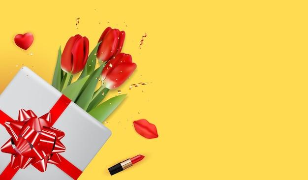 Gelber hintergrund mit roten tulpen.