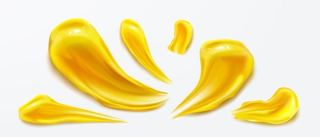 Gelber pinsel streicht flüssige farbe