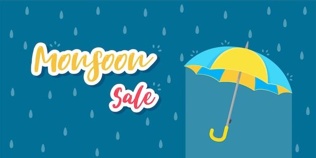 Gelber regenschirm zum schutz vor regenstürmen während des monsuns. verkauf für die regenzeit
