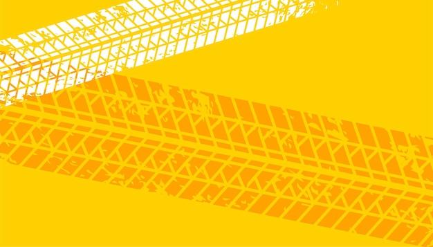 Gelber reifen verfolgt aufdruckhintergrund