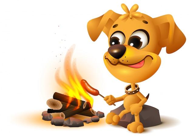 Gelber spaßhund brät wurst am feuerpfahl