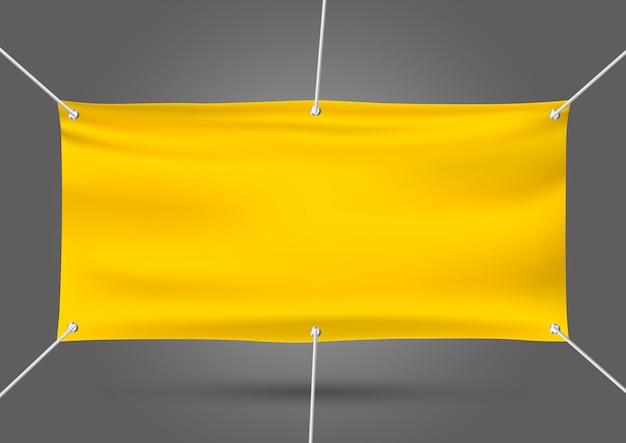 Gelber spott herauf vinylfahne auf grau