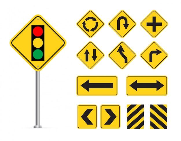 Gelber verkehrszeichensatz lokalisiert auf weißem hintergrund