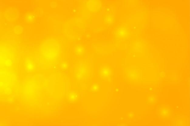Gelbes bokeh mit funkelndem lichtdesign