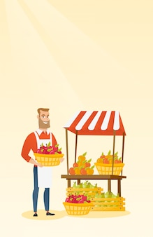 Gemüsehändler, der kasten voll von den äpfeln hält.