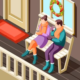 Gemütliche winterweihnachtsillustration mit jungem paar, das auf veranda sitzt und mit heißem getränk isometrisch aufwärmt