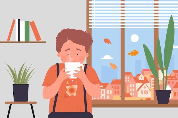 Gemütliche zeit zu hause kind mit tee- oder schokoladenbecherjunge, der heiße teetasse in den händen hält