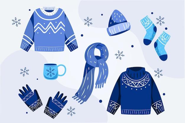 Gemütliches winterkleidungspaket mit flachem design