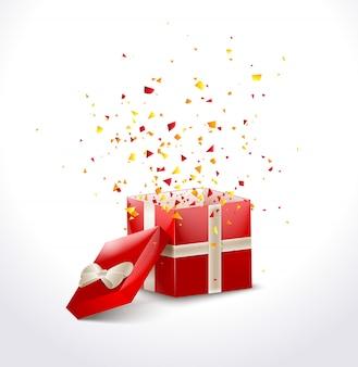 Geöffnete rote geschenkbox mit band und fliegenden konfetti