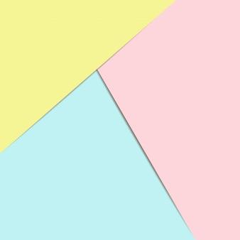 Geometrischer hintergrund des blauen, rosa und gelben papiers