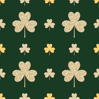 Geometrisches nahtloses muster mit goldenen shamrocks auf grün