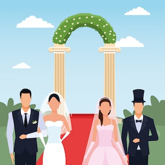 Gerade verheiratete paare, die über blumenbogen und landschaft stehen