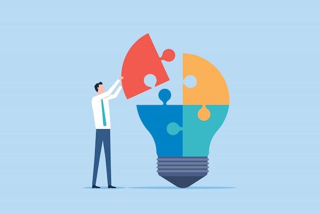Geschäftsdenken und kreativitätskonzept und geschäftsmann mit glühbirne