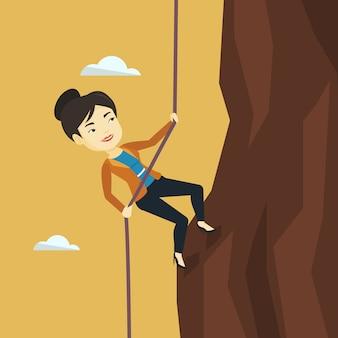 Geschäftsfrau, die auf den berg klettert.