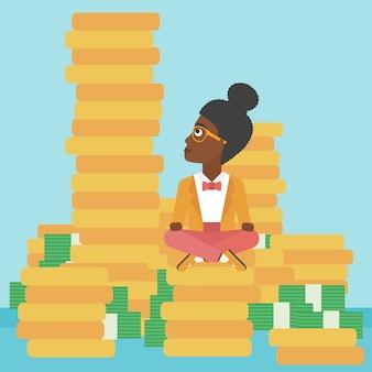 Geschäftsfrau, die auf gold sitzt