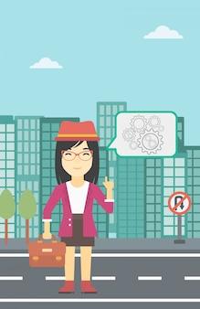 Geschäftsfrau, die auf zahnräder zeigt