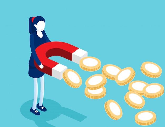 Geschäftsfrau, die magnete hält, um goldmünzen anzuziehen.