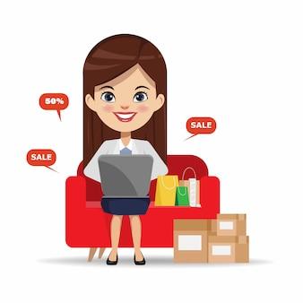Geschäftsfrau, die online mit einer laptop-computer kauft.