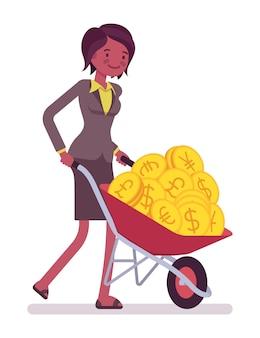 Geschäftsfrau, die voll eine schubkarre der goldenen münzen drückt