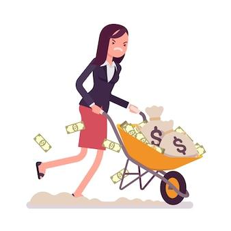Geschäftsfrau, die voll eine schubkarre des geldes drückt
