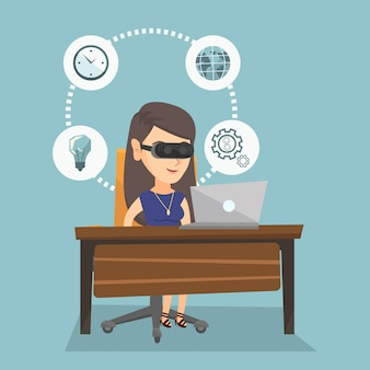 Geschäftsfrau im vr kopfhörer, der an einem computer arbeitet