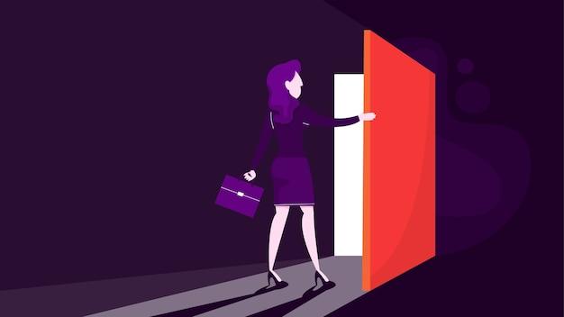 Geschäftsfrau in einem anzug hält aktentasche und öffnet die tür