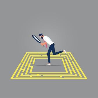 Geschäftsfrau mit lupe, um labyrinth auf dem boden zu betrachten finden sie einen ausweg