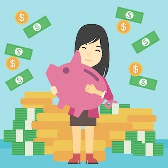 Geschäftsfrau mit sparschwein