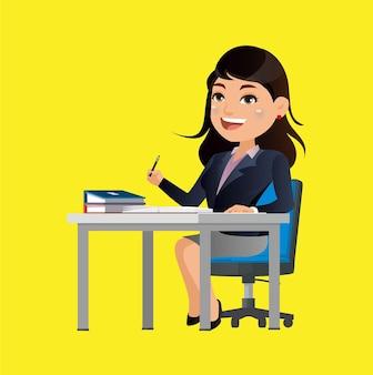 Geschäftsfrau sitzt am tisch