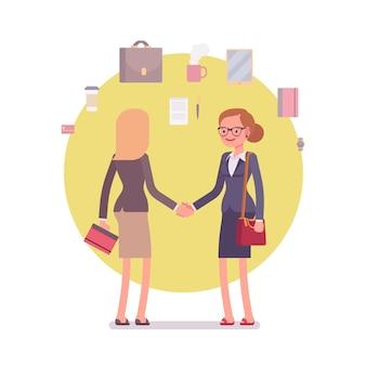 Geschäftsfrauen begrüßen händeschütteln
