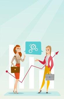 Geschäftsfrauen, die finanzdaten analysieren.