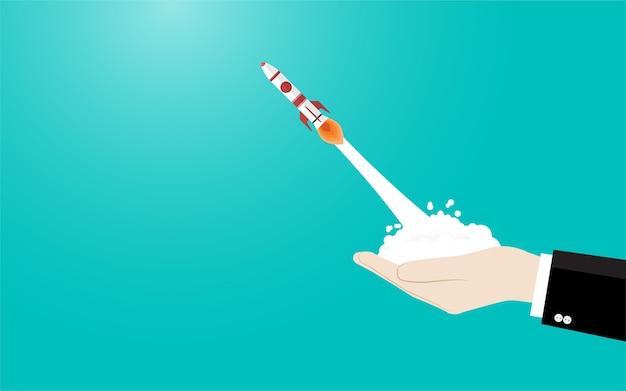 Geschäftshand der rakete