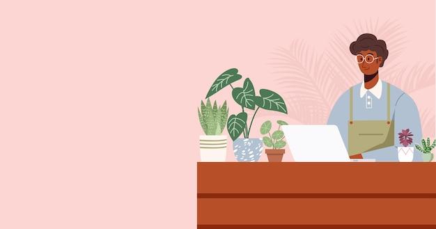 Geschäftsinhaber, der am laptop am schreibtisch in der pflanzengeschäftsillustration arbeitet