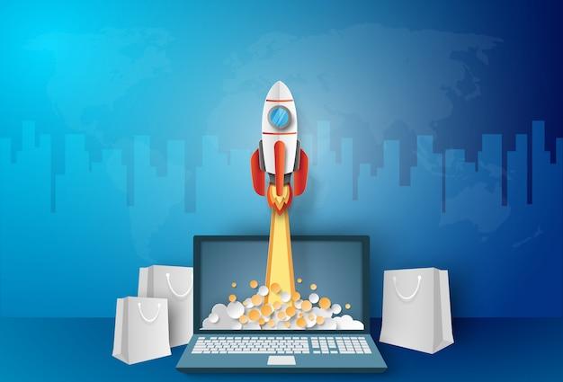 Geschäftskonzept, rakete, die vom laptop mit papiertüte startet