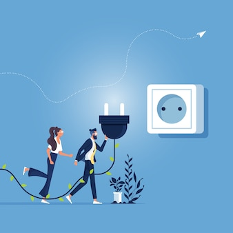 Geschäftsleute, die elektrischen grünen stromstecker in der hand halten