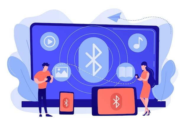 Geschäftsleute, die geräte verwenden, die mit bluetooth verbunden sind. bluetooth-verbindung, bluetooth-standard, konzept für die drahtlose kommunikation von geräten