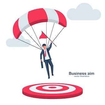 Geschäftsmann auf einem fallschirm mit einer flagge landet auf ziel. symbol champion