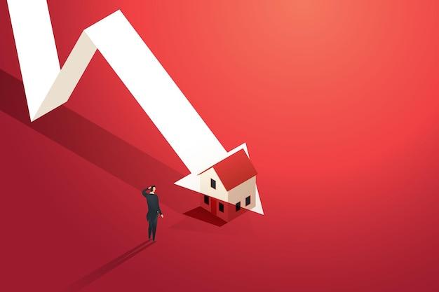 Geschäftsmann betrachtet ein diagramm des immobilienmarktes, in dem die pfeilspitze fällt