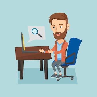 Geschäftsmann, der an seinem laptop arbeitet.