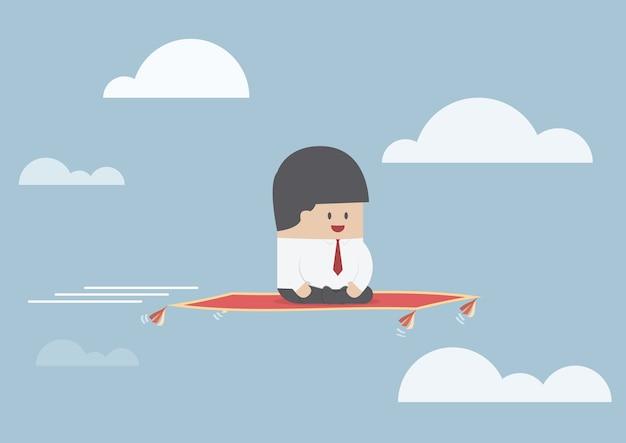 Geschäftsmann, der auf dem fliegenteppich sitzt
