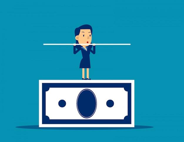 Geschäftsmann, der auf der banknote balanciert