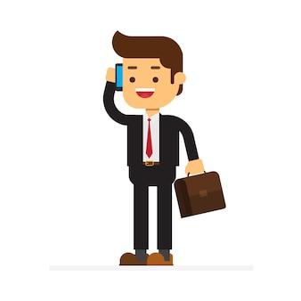 Geschäftsmann, der auf einem mobiltelefon an einem büroarbeitsplatz spricht